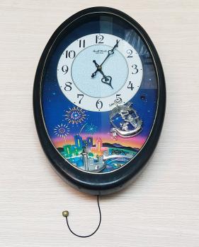 Đồng hồ Small World Rhythm hình Oval, Quả Lắc Couple Ship, Bộ Kim nhảy theo nhạc (Melody Dancing) - Mã số: RHY 709