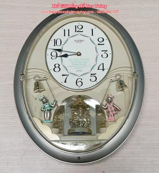Đồng hồ Rhythm Small World Oval, Kết hợp 2 kiểu Quả Xoay và Hình tượng kéo chuông phát nhạc báo giờ - Mã số: RHY 710
